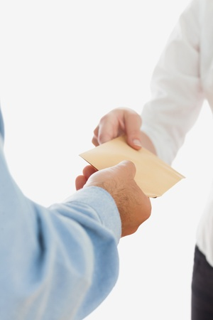 Close-up of businessman handing over bribe to business woman on white background Stock Photo - 18123174
