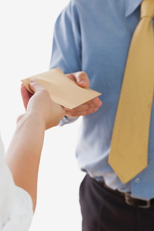 Close-up of business woman handing over bribe to businessman over white background Stock Photo - 18123790