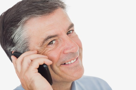 Portrait of businessman using cell phone over white background photo