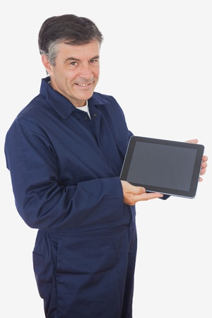 Portrait of mature mechanic displaying digital tablet over white background photo