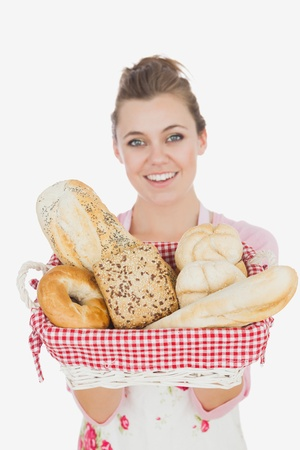 Portrait of young maid holding bread basket over white background Stock Photo - 18106224