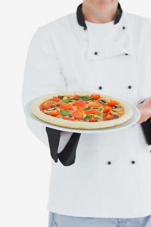 Male chef offering pizza over white background Stock Photo - 18102186