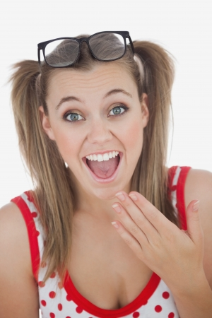 ponytails: Portrait of surprised  young woman with ponytails over white background Stock Photo