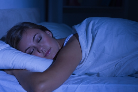 fair woman: Serene woman sleeping at night in the bedroom