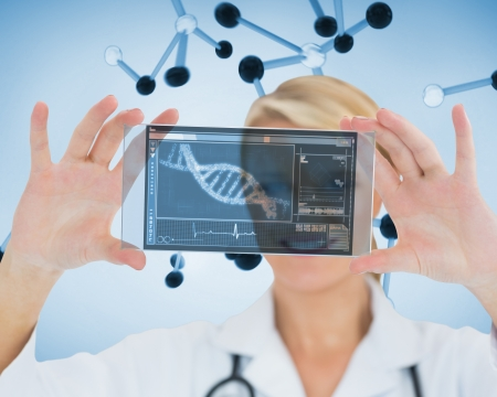 Smiling nurse holding a virtual screen in front of camera Stock Photo - 18106911