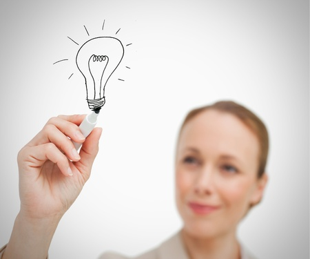 blonde blue eyes: Smiling woman drawing black bulb with marker Stock Photo