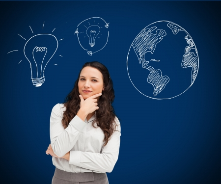 Businesswoman standing against a picture of bulbs and globe in background photo