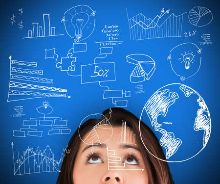computations: Woman standing against a blue background looking up on the picture of various computations Stock Photo