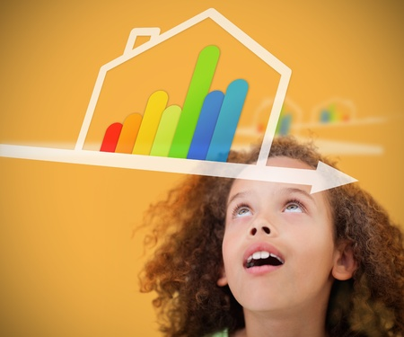 child looking up: Girl looking up on the nergy efficient house on yellow background