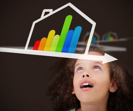 child looking up: Surprised girl looking up on the picture with energy efficient house graphic Stock Photo