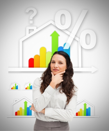 Smiling woman standing against energy efficient house graphic on white background photo
