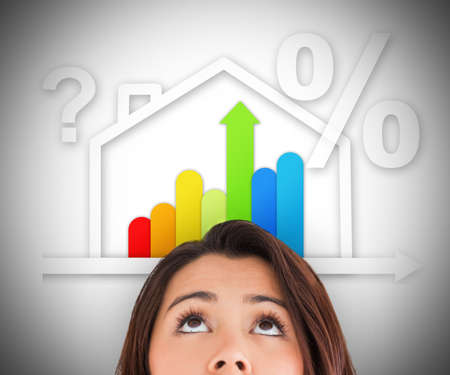 Woman looking up at energy efficient house graphic with question and percentage marks photo