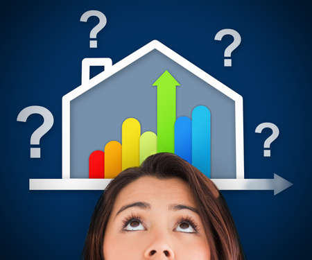 View of woman looking up at energy efficient house graphic with question and percentage marks photo