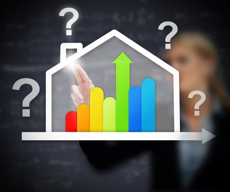 Businesswoman working with energy efficient house graphic with question marks on touch screen photo