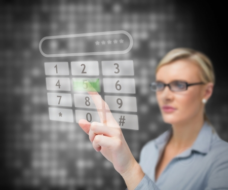 entering information: Business woman dialing number against a background