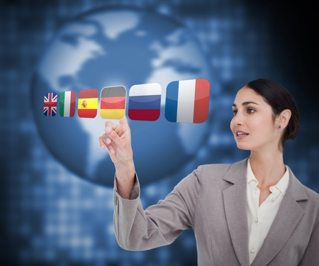 Businesswoman choosing Germany flag on touch screen photo