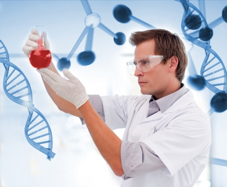 Biologist examining a beaker of blood on digitally generated background photo