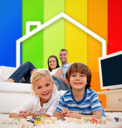 happy couple at home: Two children lying on a carpet in front of house illustration and energy efficiency lines in the living room