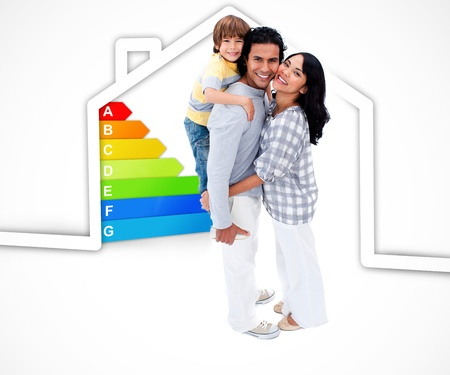 piggyback: Smiling family standing with a house illustration with energy rating graphic on a white background