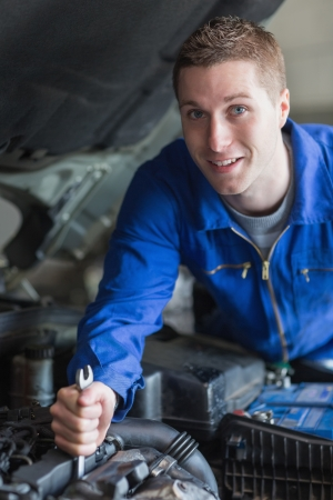 Portrait of young man working on car engine Stock Photo - 18109818