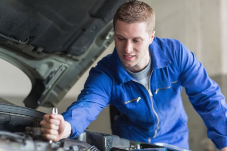 Young mechanic working on automobile engine Stock Photo - 18110487