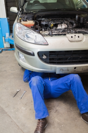 Auto mechanic working under car in garage Stock Photo - 18109908