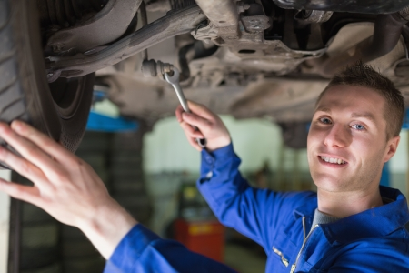 Portrait of male mechanic working under car Stock Photo - 18109609