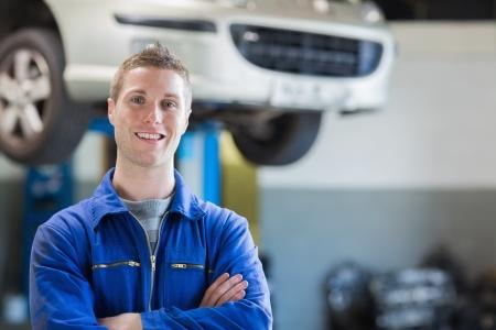 auto mechanic: Portrait of confident male mechanic in workshop Stock Photo