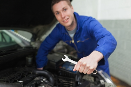 Portrait of auto mechanic with spanner repairing car Stock Photo - 18108626