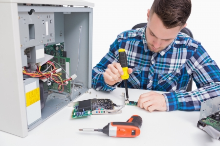 Computer engineer repairing cpu over white background photo