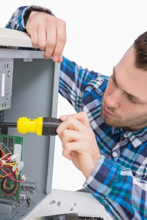 Close-up of young computer engineer working on cpu over white background photo