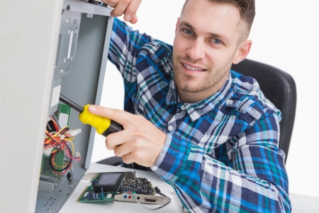 it tech: Portrait of computer engineer repairing cpu over white background