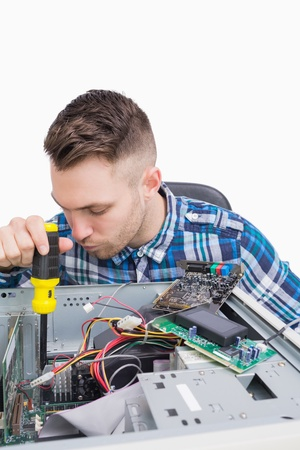 Young computer engineer working on cpu over white background photo