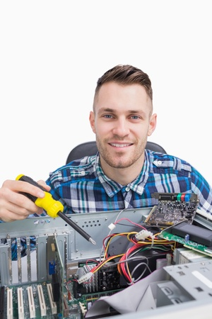 Portrait of computer engineer repairing cpu over white background photo