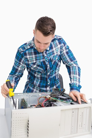 Young it professional repairing cpu over white background photo