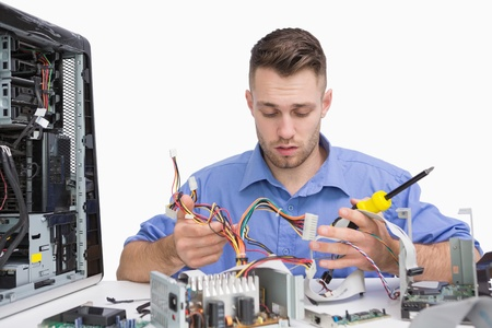 repairing: Young computer engineer working on cpu parts over white background