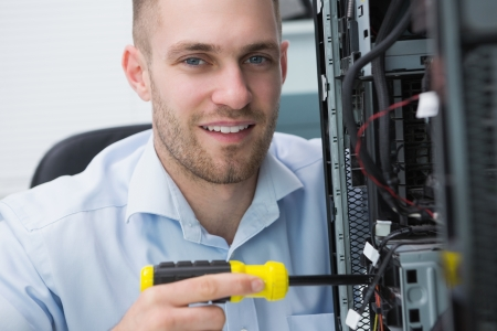 Close-up portrait of young computer engineer working on cpu Stock Photo - 18109085