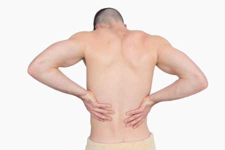 back  view: Rear view of shirtless man with back pain over white background