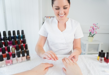nail varnish: Woman receiving manicure treatment at nail spa
