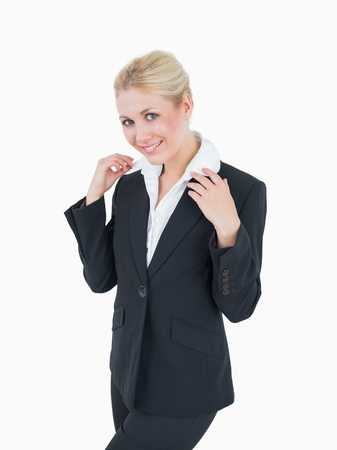 Portrait of confident young business woman standing over white background