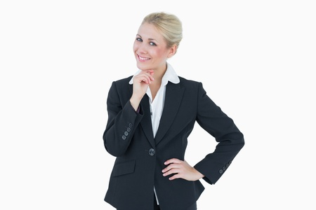 Portrait of confident young business woman standing over white background photo