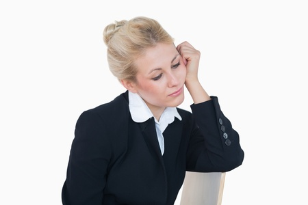 Serious young business woman in thought over white background Stock Photo - 18101287