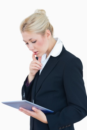 Young business woman using digital tablet over white background photo