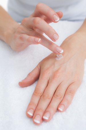Close-up of woman applying cream on hand Stock Photo - 18107854