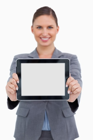 well dressed  holding: Portrait of smiling business woman holding digital tablet over white background Stock Photo
