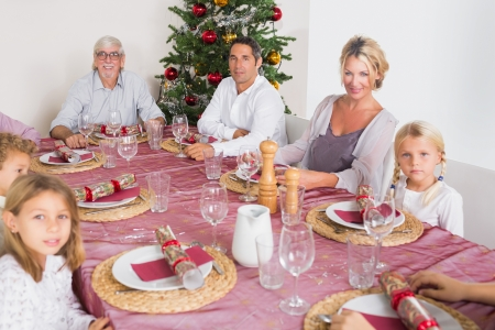 Smiling family at the dinner table at christmas photo