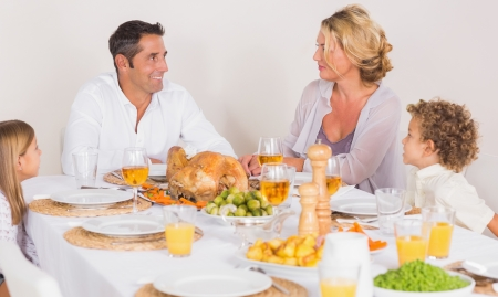 Family talking together before to eat a turkey photo