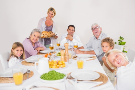 Woman holding a turkey for family dinner and looking at camera photo