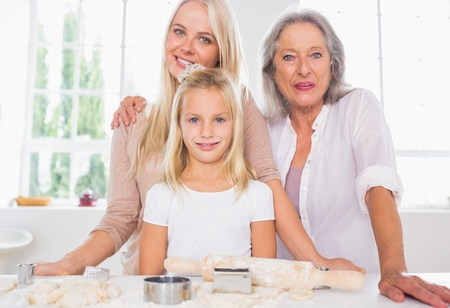 Mothers and daughters cooking together in the kitchen photo