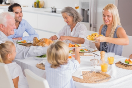 multiracial family: Happy Family eating the thanksgiving dinner together Stock Photo